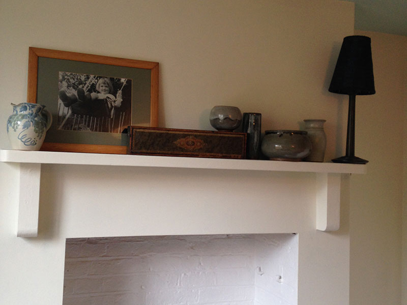 Pretty tonal mantelpiece arrangement